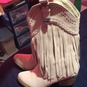 Fringe cowgirl boots. More like dress boots